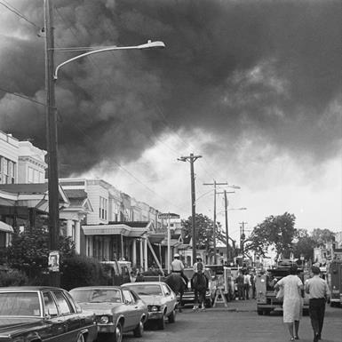 Smoke billows over rowhouses in the West Philadelphia