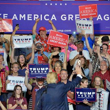 Republican presidential nominee Donald Trump waves to supporters