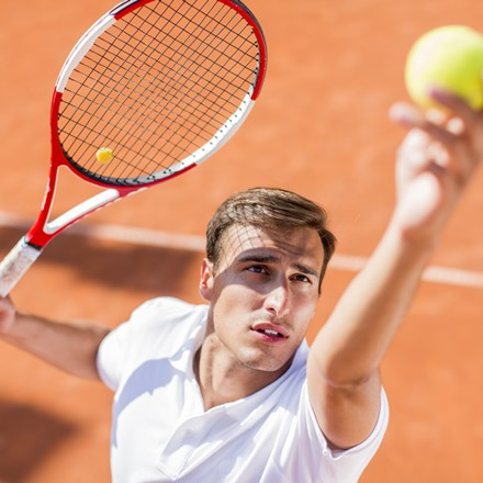 White man playing tennis shutterstock 208682983