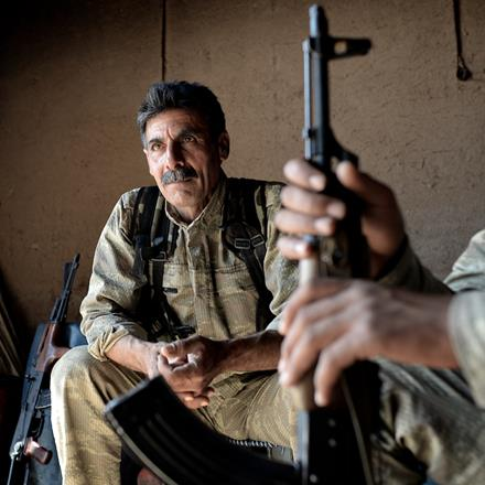 YPG fighters rest at a frontline position in their war against ISIS.