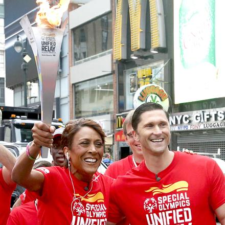 Robin Roberts starts the Flame of Hope torch run through the streets of New York City.