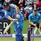 Rohit Sharma (L) of India plays the ball during the second one-day international cricket match between England and India at the Glamorgan County Cricket Ground in Cardiff, Wales